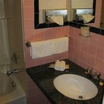Majer's bathroom with pink and black tile retro style