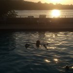 Swimming in the pool by the river and sunset