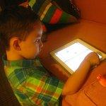 My son enjoying his Ipad games using the Hotel WiFi