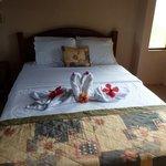 Artful towel and flower arrangement