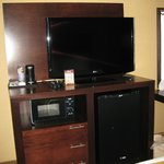 Large HDTV with microwave, fridge and coffeemaker