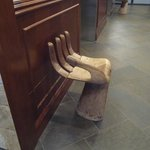 Hand shaped chairs by the elevator where small guests can sit and get their picture taken