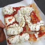 oregano, tomato sauce and stracchino cheese pizza