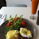 Eggs Benedict and carrot/ginger juice