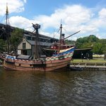 A Replica of Henry Hudson's vessel moored near the Maritime Museum, Seen from the Rip Van Winkle