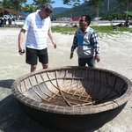 "Quang explaining how the ""basket fishing boats"" are made and used"