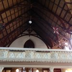 The timber work in the ceiling and fancy railing in the gallery.