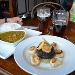 Curry dish and Scallops with black pudding