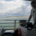 Captain Joe at the helm of the Horseshoe Crab, the Eco Tour's boat