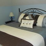 Bedroom with queen size bed. Each room has a flat screen TV