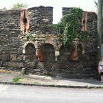 Part of the old wall around the city with its defensive archer ports still intact.