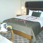 view of our complimentary champagne, fruit, chocolates & nuts along w/requested rose petals on b