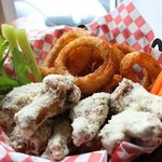 Mayday wings with seasoned onion rings!