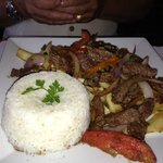 steak and fries with rice and onions