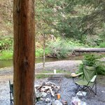 View of fire pit and creek from the porch of Spring Cabin