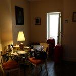 Sitting area - bathroom through door, small kitchenette on right