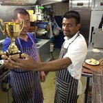 Here the chef has won a trophy for the best food in pool league. good work guys