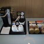 The coffee maker and cookies