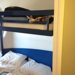 Low top bunk above double bed
