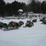 Plenty of parking for snowmobiles, accessible by our own groomed trails