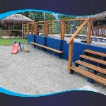 We've created the perfect place for the kids to play while you enjoy a stress free cocktail