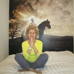 Queen bed with mural painted by Dennis Diem