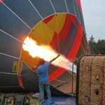 Gas is pumped into the balloon to stand it upright