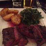 Flank steak with roasted Rosemary potatoes and spinach.