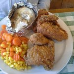Fried Chicken Dinner with baked potatos and veggies