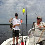 Capt. Piper and our son Seth with an (undersized) flounder.