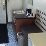 Second sink and large mini-fridge by door from parking lot
