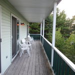 Long porch shared by all but each unit has 2 chairs and table.