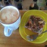 A cup of Hazel Nutty & cinnamon bun cake