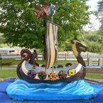 A replica of a Viking ship at a Norway-themed hole.