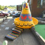 A colorful sombrero decorates this hole.