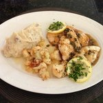Chicken Piccata, mashed potatoes and vegetables.