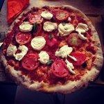 A giant Caprese pizza, delicious!