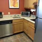 kitchen: cabinets are a bit shabby but new appliances!