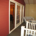 Lovely front porch in need of new furniture and windows that open.