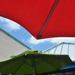 Festive umbrellas cover benches outside the main entrance.