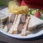 Pork sausage and onion sandwich