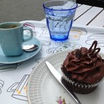 Espresso, cupcake break at one of the outside tables.