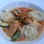 Salmon soup with ravioli and vegetables