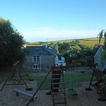 View over play area and beech cottage to rolling hills