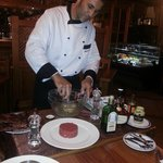 Steak tatare being prepared at our table
