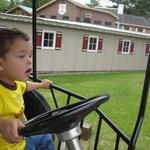 kids drive cars on a rail (can control steering - a little - and speed)