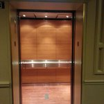 Elevators default to lobby minimizing wait times