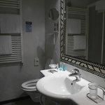 Bathroom with mosaic mirror