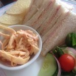 Sandwiches served with crisps and homemade coleslaw