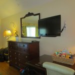 Wall-mounted television and chest of drawers